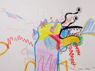 Student drawing in crayon of a creature invented from a traced hand drawing