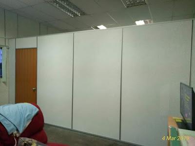 Pemasangan partition di ruang dalam pejabat