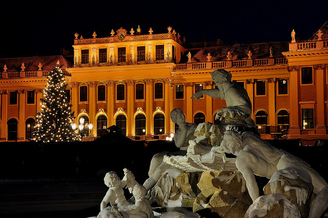 Austria's sprawling Schönbrunn Palace glows with the warmth of Christmas. Photo: Property of Viking River Cruises. Unauthorized use is prohibited.