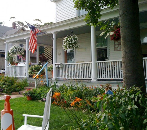 Front porches the american flag for Front porch hanging plants