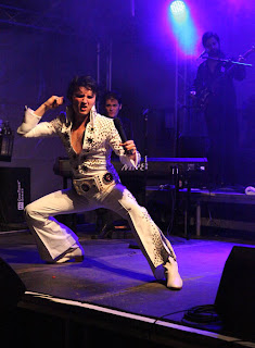ben portsmouth onstage as elvis doing karate moves