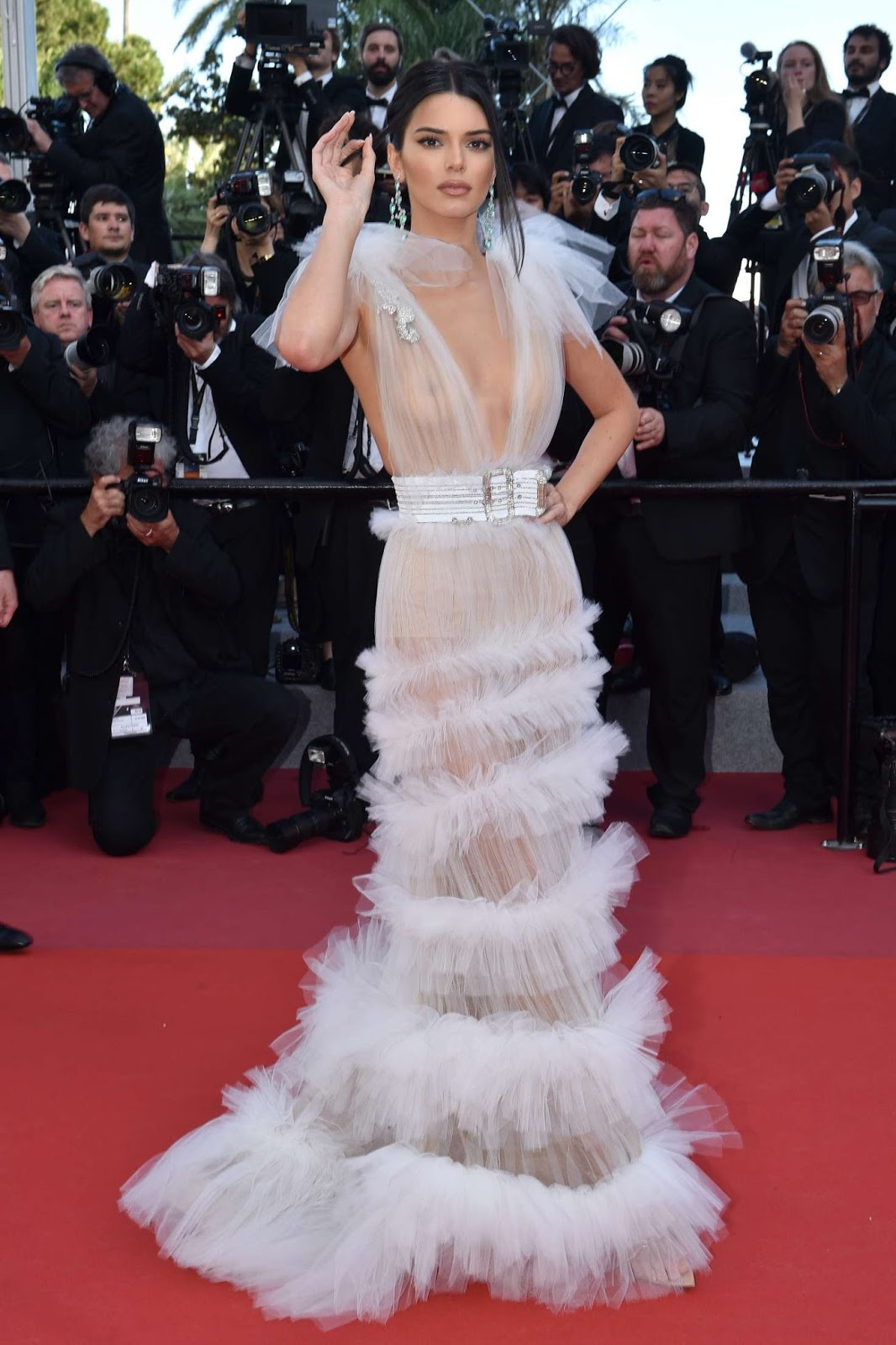 Kendall Jenner bares all as she went braless in transparent frilled gown at the star-studded Girls of the Sun premiere at Cannes Film Festival