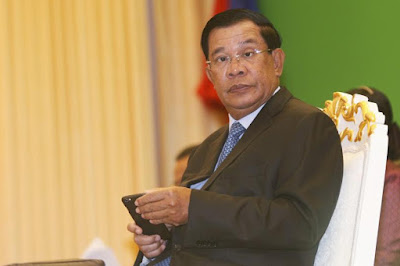 Cambodian PM orders probe political analyst's murder