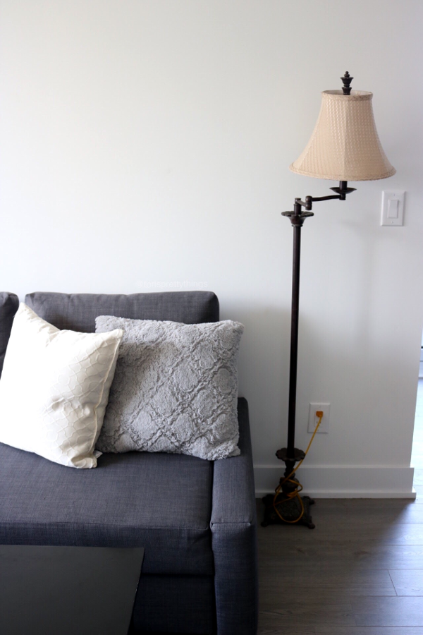 Gray and white throw pillows, gray couch, old lamp - Tori's Pretty Things Blog