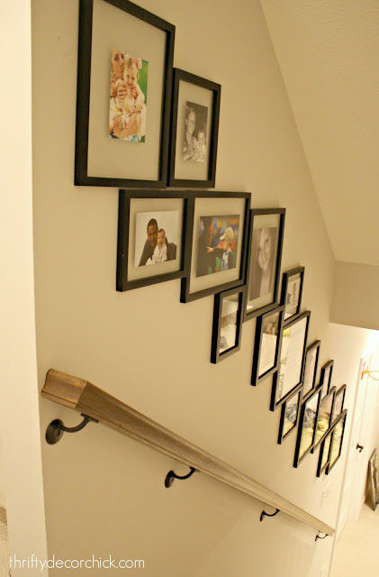 Gallery wall with design going down the stairs