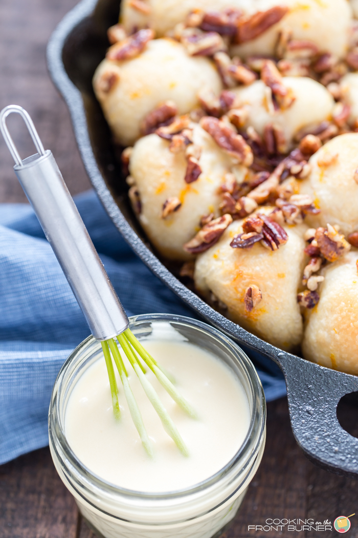 Orange Pecan Pull Apart skillet rolls will become your favorite breakfast treat! With creamy orange glaze and crunchy pecans, these pull apart rolls are great for breakfast, brunch, or holidays.
