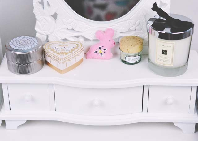 Items displayed on a dressing table mirror