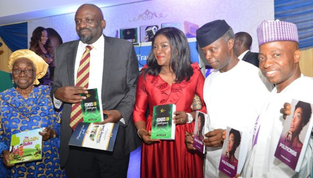 Osinbajo, second right help to present the books