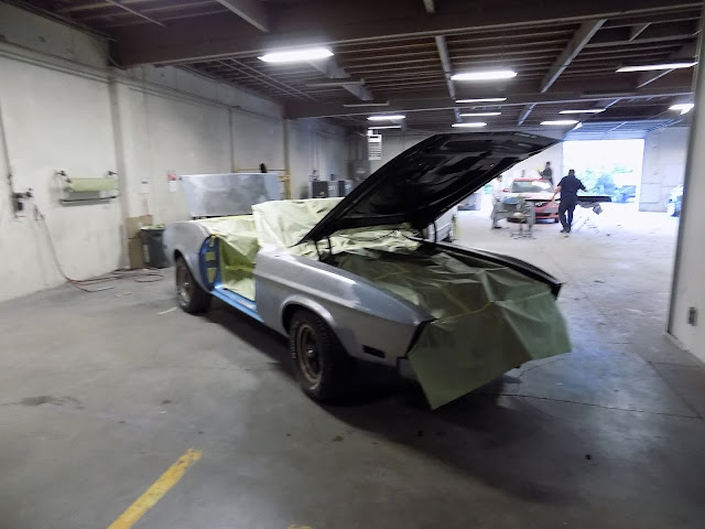 1973 Mustang with door off, interior & engine masked for jambs to be painted.
