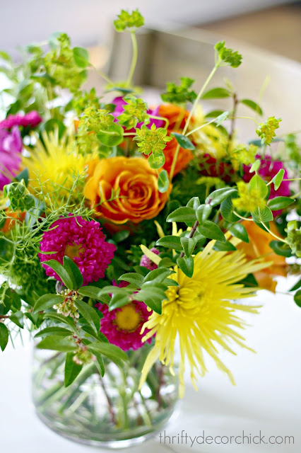Bright floral arrangement with roses, mums and asters