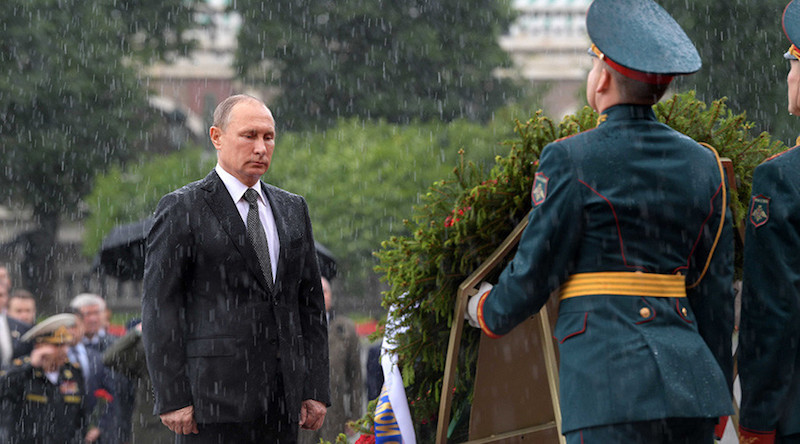 Vladimir Putin standing in the rain while paying tribute to soldiers from WWII. June 2017