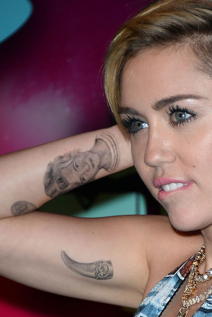 Miley Cyrus Right Hand Tattoos