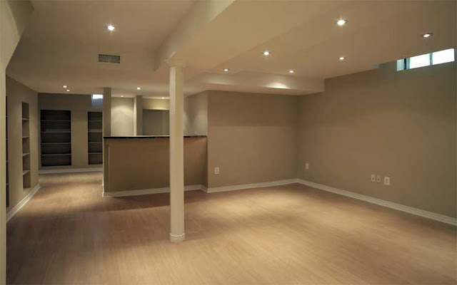 likeable basement finishing ideas with laminate wood flooring and brown wall