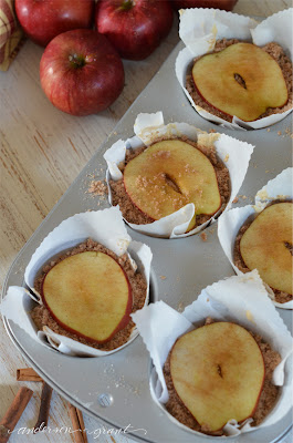 Top each apple muffin with crumb topping and a slice of apple | www.andersonandgrant.com