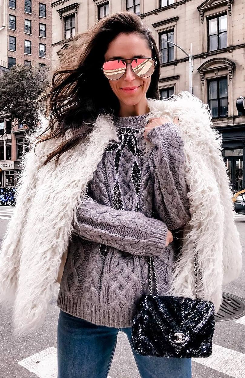 what to wear with a knit sneakers : fur jacket + skinnies + glitter bag