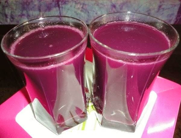 black grape juice in serving glasses