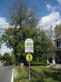 Maryland Scenic Byway C&O Canal Tour sign with Best Buddies route sign