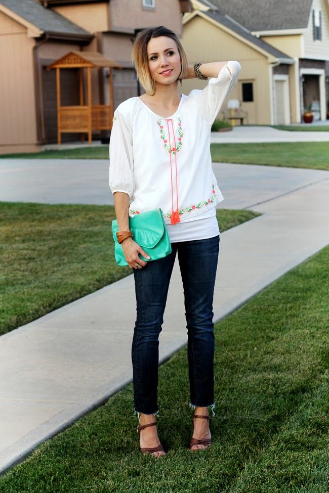 embroidered tunic, dark straight denim and wedge sandals