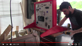 man making a sensory board