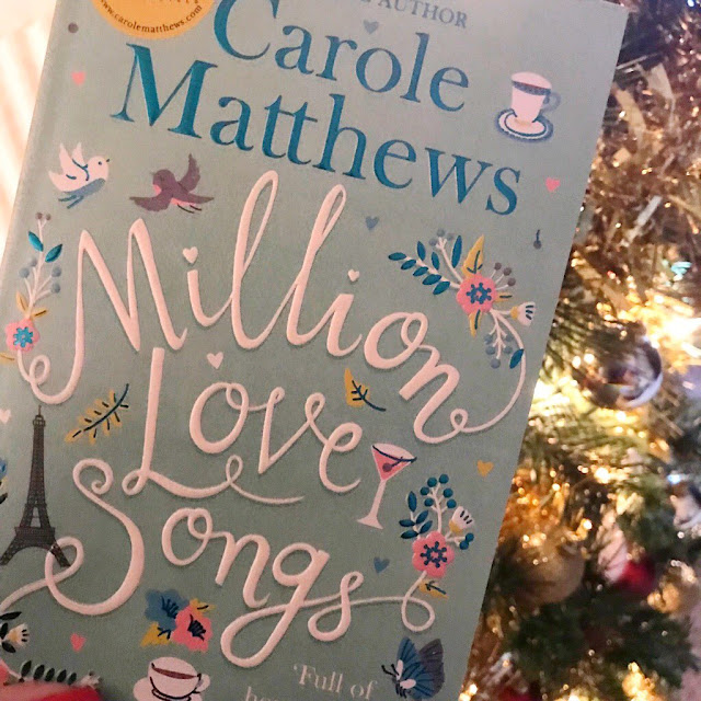 Million Love Songs book in front of Christmas tree