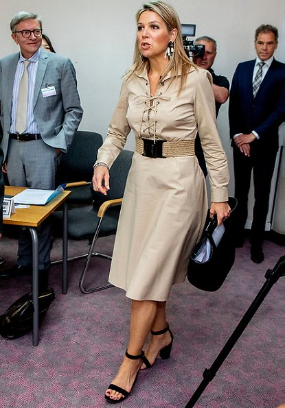 Queen Maxima wore a Polo Ralph Lauren lace-up cotton poplin dress, Gianvito Rossi sandals, and carried Marina Raphael bag