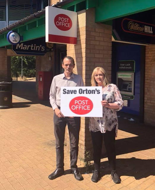 Alex with Peterborough City Councillor Julie Howell outside the post office in Herlington.