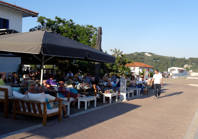Cafe terrace scene at the old port of Skiathos