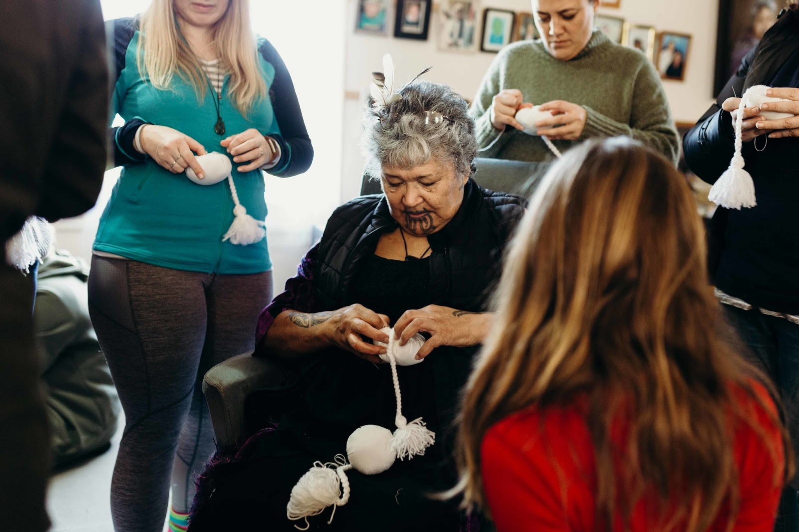 "Whaea Maata teaches us to make ""poi karakia o Parihaka"" (white prayer poi, specially made and blessed at Parihaka)"