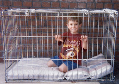 Zack playing in Granny's dog cage, dog kennel