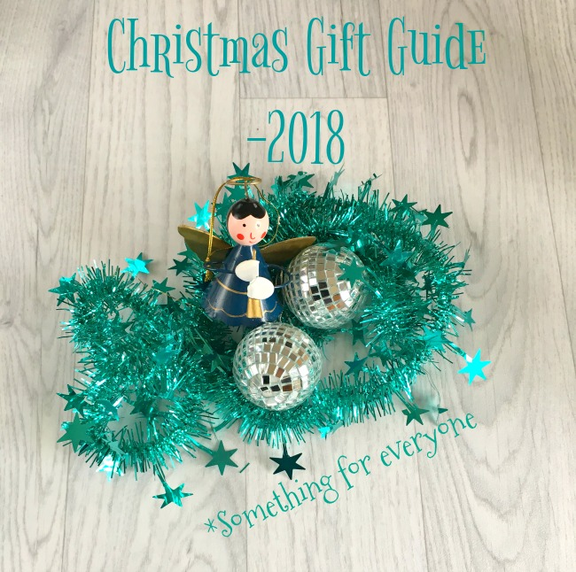 Christmas-gift-guide-2018-something-for-everyone-text-over-image-of-christmas decorations