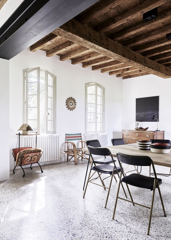 hellolovely-french-farmhouse-black-dining-room-modern-chairs-camargue-france