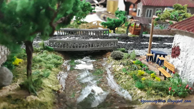 Miniature bridge and river diorama