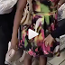 See how this woman caught stealing hid 9 clothes in her pant (WATCH)