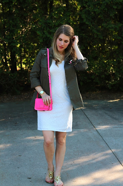 white tank dress, olive military jacket, gold rope sandals, pink Kate Spade crossbody bag