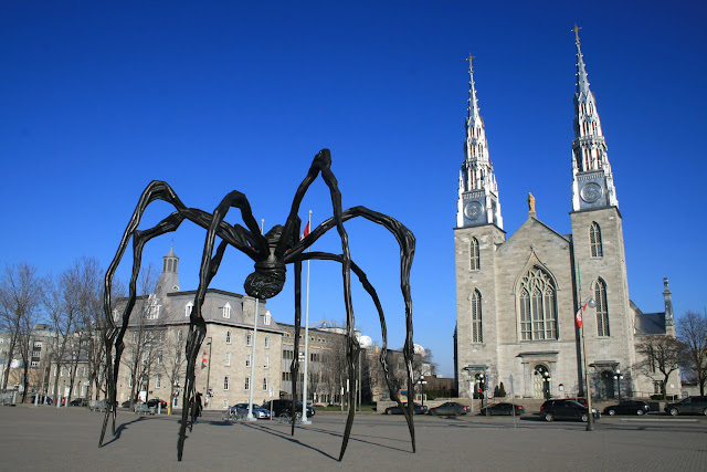 """Maman"" gazing at Ottawa's Notre Dame Cathedral"