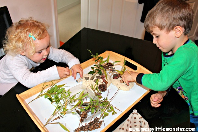 Woodland small world playdough activity for kids. Toddlers and preschoolers will love collecting nature and using it with playdough to create a miniature woodland scene. This activity is great for imaginative play and animals/ woodland project.