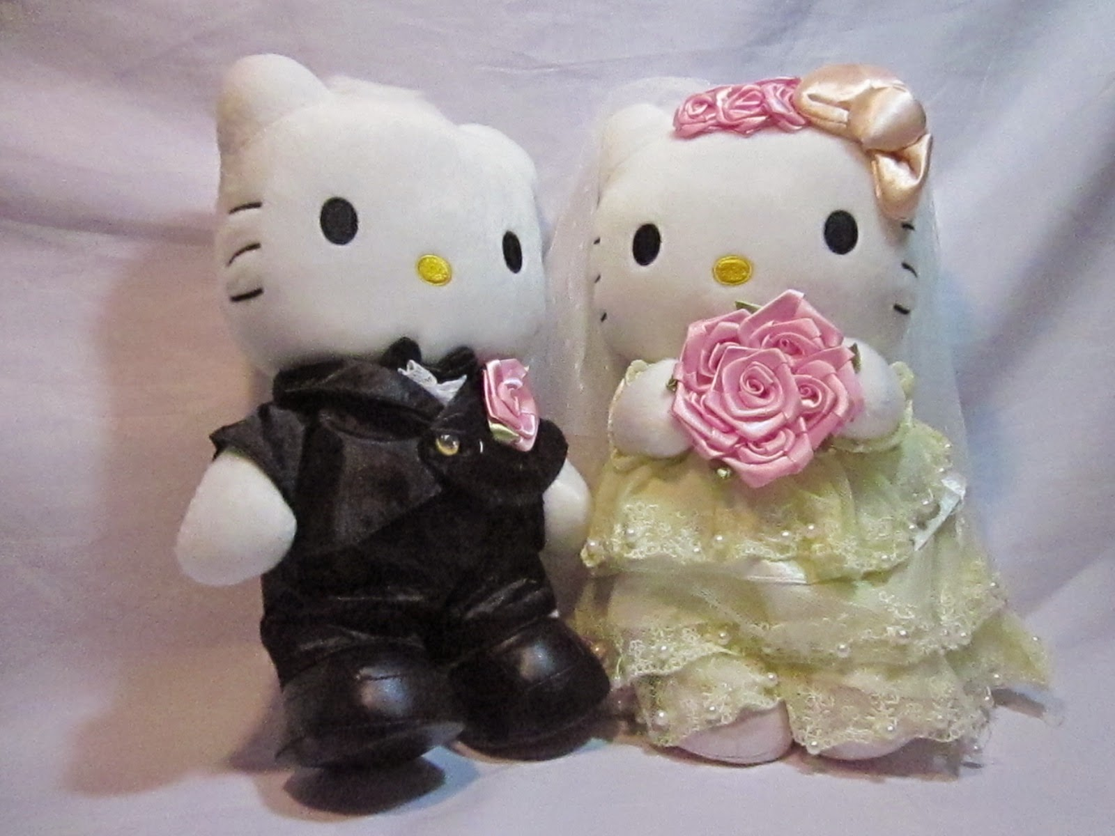 Gratis gambar boneka hello kitty berpasangan
