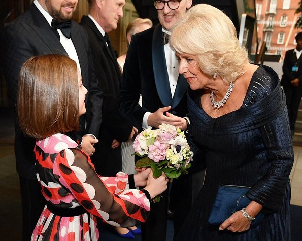 The Duchess of Cornwall is wearing a Bruce Oldfield gown with her pear-shaped diamond parure