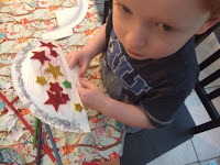 Toddler with his handmade fan