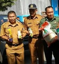 Kepala Dinas Koperasi dan Perdagangan Kabupaten Asahan Witoyo, Kodim 0208 Asahan di acara peluncuran beras Rp9.950 per kg.