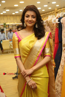 Actress Kajal Agarwal Stills in Golden Silk Saree at Trisha Sesigner Store Launch  0090.jpg