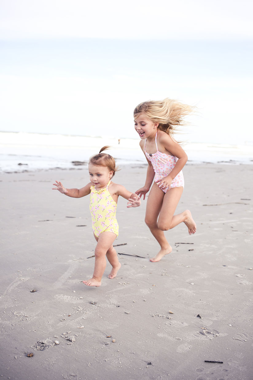 Sisters play on the beach in swimwear by Sunuva