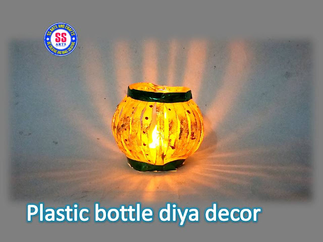 Here is how to decorate diyas at home,how to diya decor with plastic bottle,diya decor for diwali,diwali room decor ideas,how to diya lamp with plastic bottle,Plastic bottle diya lamp best out of the waste,reused crafts for diwali,How to make diwali diya decor with plastic bottle
