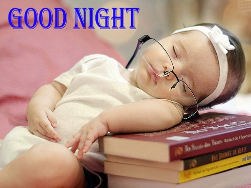 Cute Baby Sleeping on Books and Wishing Good Night