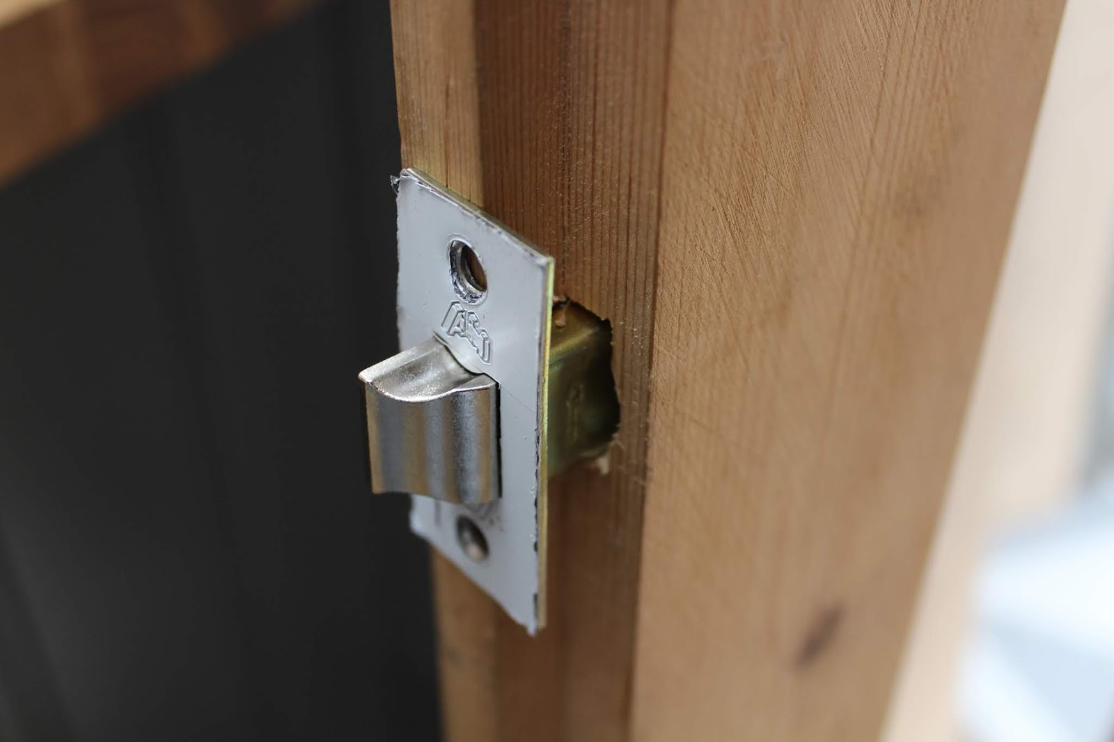 Rebated door latch on french door