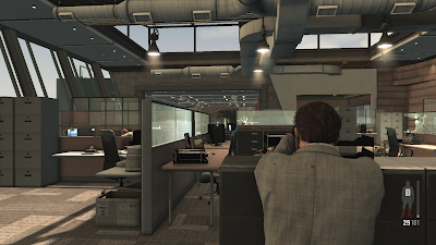 An office shootout in the PC version of Max Payne