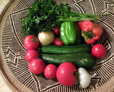 Basket of veggies: zucchini, tomatoes, red and green bell pepper, parsley, onion, garlic