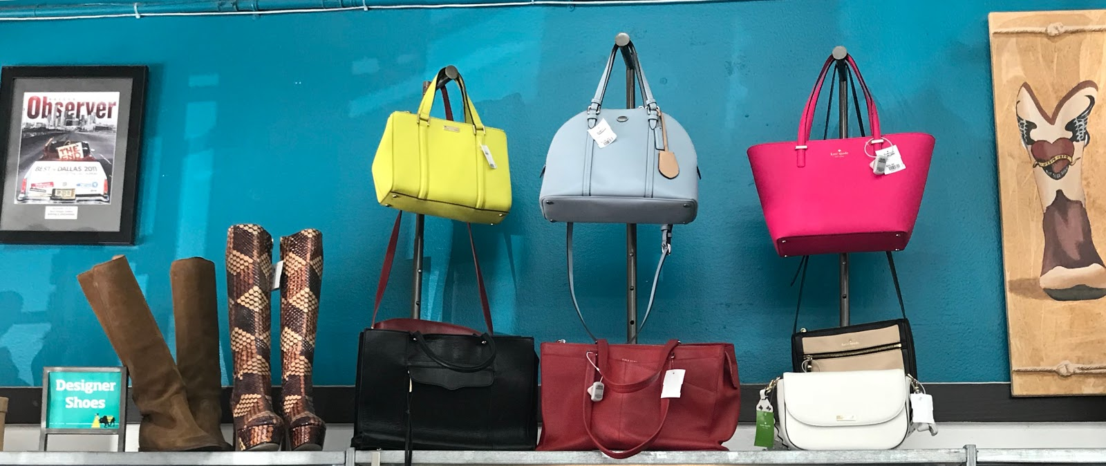 Image: Boots, handbags hanging at the thrift store