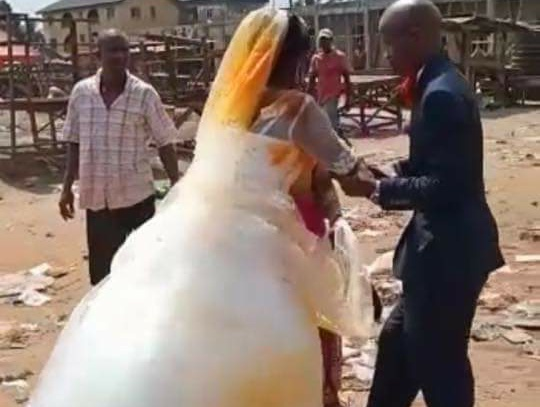 First wife poured red oil on the second wife wedding gown