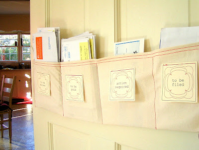 Create a diy mail sorter with this simple tutorial from bright and blithe blog. Made from unbleached cotton, this mail sorter can be hung on a neighboring door or wall. The tutorial includes printable labels for action required, to be paid, to be filed, and to be sorted.